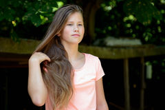 Young teenage girl in the park with  facial expression. Royalty Free Stock Photos