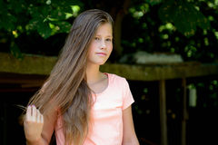 Young teenage girl in the park with  happy facial expression. Royalty Free Stock Image