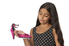 Young teenage girl with a pink highheel shoe. On white background stock photography