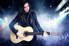Young teenage girl playing on guitar. Royalty Free Stock Image