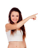 Young teenage girl pointing at something Royalty Free Stock Photos