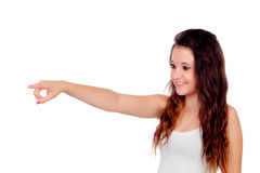 Young teenage girl pointing at something Royalty Free Stock Images