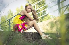 Young teenage girl posing with a cute smile Royalty Free Stock Photos