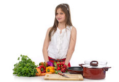 A young teenage girl preparing food Stock Photography