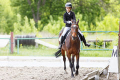 Young teenage girl riding horse on dressage Royalty Free Stock Photography