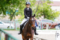 Young teenage girl riding horse on dressage Stock Image