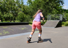 Young teenage girl rollerblading Royalty Free Stock Photo