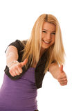 Young teenage girl showing thumb up as a sign of success and hap Royalty Free Stock Photo