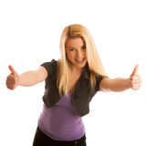 Young teenage girl showing thumb up as a sign of success and hap Royalty Free Stock Photography