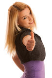 Young teenage girl showing thumb up as a sign of success and hap Stock Photography