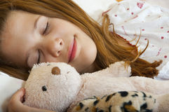Young teenage girl sleeps peacefully Stock Photos