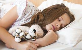 Young teenage girl sleeps peacefully Stock Photos