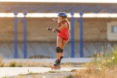 Young teenage girl speed skating on rollerdrome stock photo