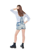 Young teenage girl standing and looking on something. Back pose,. Young teenage girl standing and looking on something isolated. Back pose, full length royalty free stock photo