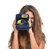 Young teenage girl taking photo holding old retro camera Stock Photos