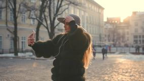 Young teenage girl taking photo or making selfie stock footage