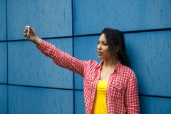 Young teenage girl taking photo by mobile phone. royalty free stock photo