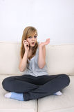 Young teenage girl talking on cellphone Royalty Free Stock Photography