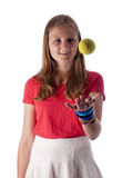 Young teenage girl throwing a tennis ball in the air Stock Photos