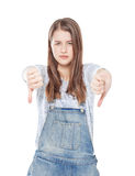 Young teenage girl with thumbs down gesture isolated Stock Images