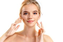 Young teenage girl touching her healthy skin stock photography