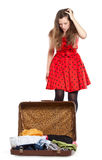 Young Teenage Girl With An Opened Suitcase Royalty Free Stock Image