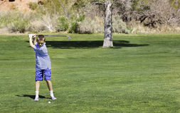 Young Teenage Golfer on the course Royalty Free Stock Photo