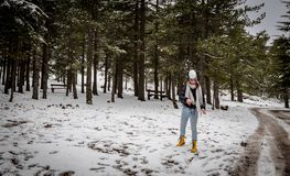 Young teenage happy girl playing with snow at Troodos mountains in Cyprus stock photo