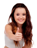 Young teenage saying Ok with focus on her thumb Royalty Free Stock Photos