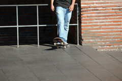A young teenage skateboarder. Wearing jeans Royalty Free Stock Photos