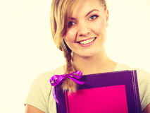 Young teenage student with braid holding books Royalty Free Stock Photo