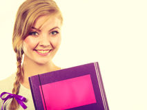 Young teenage student with braid holding books. School, education concept. Young teenage student with braid holding books, going to study Stock Photography