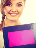 Young teenage student with braid holding books Stock Photo