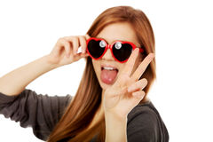 Young teenage woman wearing sunglasses Royalty Free Stock Image