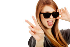 Young teenage woman wearing sunglasses Stock Photography