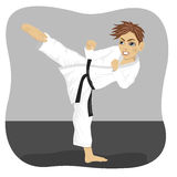 Young teenager black belt karate boy in kimono practicing kick exercise. In gym royalty free illustration