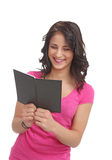 Young teenager with a book laughing Stock Photo