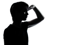 Young teenager boy girl looking foward silhouette Stock Photo