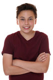 Young teenager boy portrait with folded arms. Isolated on a white background Stock Photo