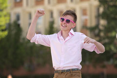 Young teenager celebrating a success Royalty Free Stock Photo