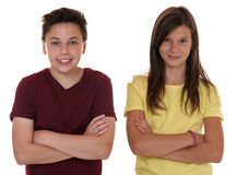 Young teenager children portrait with folded arms. Isolated on a white background Stock Images