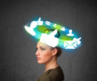 Young teenager with cloud social icons around her head Royalty Free Stock Images