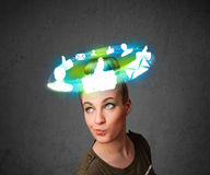 Young teenager with cloud social icons around her head Stock Photos