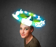 Young teenager with cloud social icons around her head Royalty Free Stock Photos