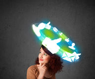 Young teenager with cloud social icons around her head Royalty Free Stock Image