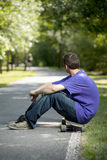 Young teenager enjoying his longboard Stock Photos