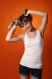Young teenager girl. Isolated on orange background Royalty Free Stock Photos