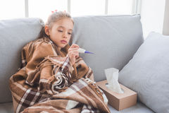 Young teenager girl alone at home childhood. Sick feeling unwell Royalty Free Stock Images