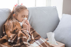 Young teenager girl alone at home childhood. Sick feeling unwell Stock Image