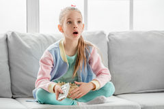 Young teenager girl alone at home childhood. Watching movie Royalty Free Stock Image